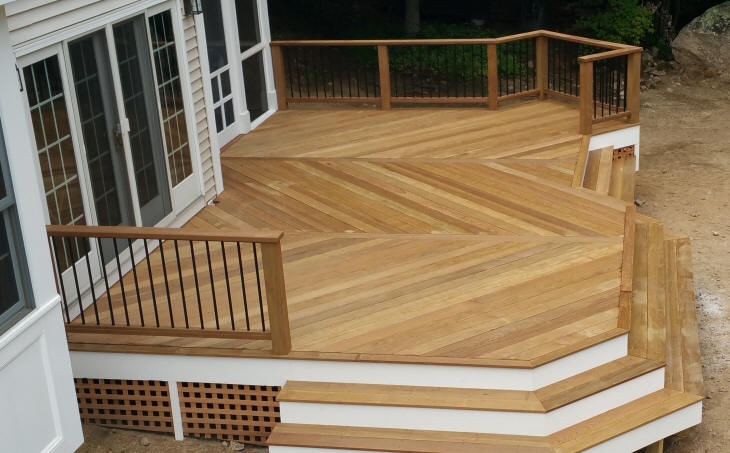 custom ipe deck low level with herringbone floor pattern and large wrapping stadium stairs deck pro builders