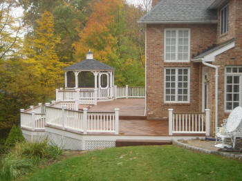 large ipe deck in avon ct with king posts and vinyl rails