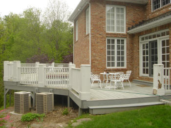 large ipe deck in avon ct with king posts and vinyl rails before