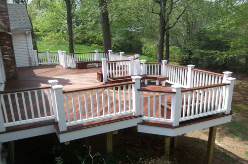 multi level ipe deck in glastonbury ct with white vinyl rails and white kingposts
