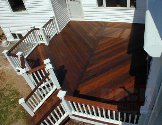 ipe deck with white vinyl rails and king posts