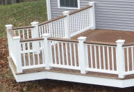 trex deck with white vinyl rails and kingposts