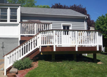 2 level ipe deck with white vinyl rails before