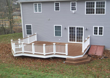 trex composite deck in manchester ct with white vinyl rails and kingposts deck builders