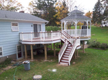 ipe deck with gazebo and turned spindles vinyl