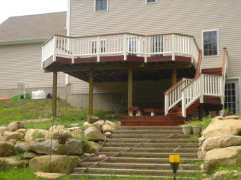 tall ipe deck with stair landing and lower level