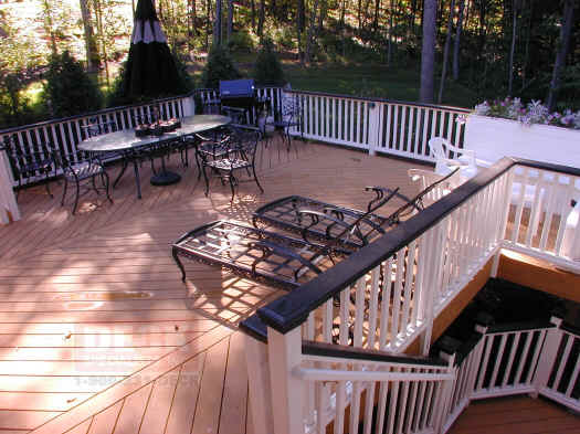 stained treated deck with planters glastonbury