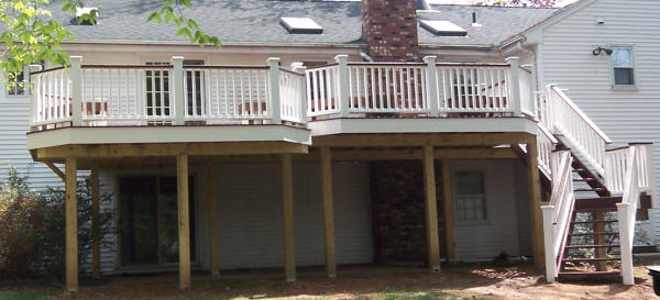 elevated ipe deck featuring white vinyl fascia king posts white vinyl rails