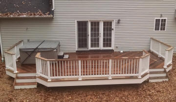 low ipe hot tub deck custom with white soldi vinyl rails and fascia ironwood
