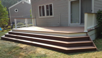 low level custom azek pvc compoisite deck with stadium stairs and herringbone floor pattern