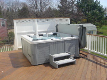 upper level ipe hot tub deck with privacy screen